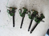 Picture of 4 John Deere RE38087 RE36939 Fuel Injectors For Parts/Untested Nozzle