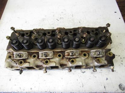 Picture of Cylinder Head off Yanmar 4JHLT-K Marine Diesel Engine