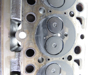 Picture of Kubota 1J800-03040 Cylinder Head to certain V2403-CR engine