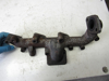 Picture of Kubota 1J811-12312 Exhaust Manifold to certain V2403-CR engine 1J811-12313