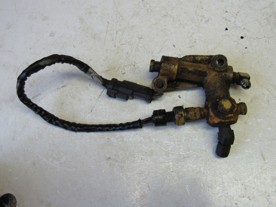 Picture of Cat Caterpiller 118-4329 Oil Valve Manifold to certain 3126 Engine 1184329